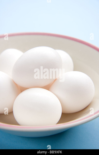 Organic eggs in a bowl - Stock Image