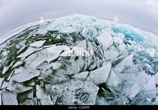 The Netherlands, Oosterleek, Piled up ice on frozen lake called IJsselmeer. - Stock Image