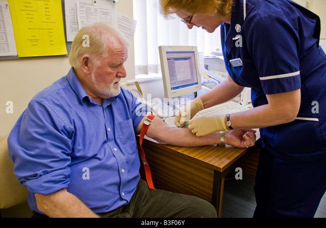MAN IN LATE 60s HAVING A BLOOD TEST UK - Stock Image