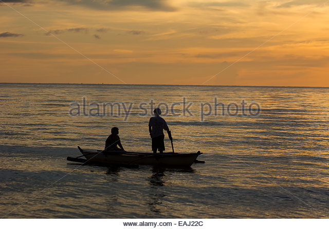 Sunset banca boat stock photos sunset banca boat stock for Videos of people fishing