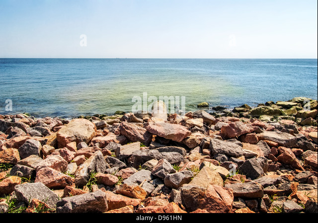 overflow pipe coming from the land to the sea - Stock Image