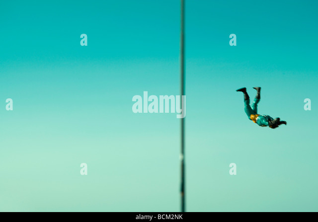 Action figure falling through air - Stock Image