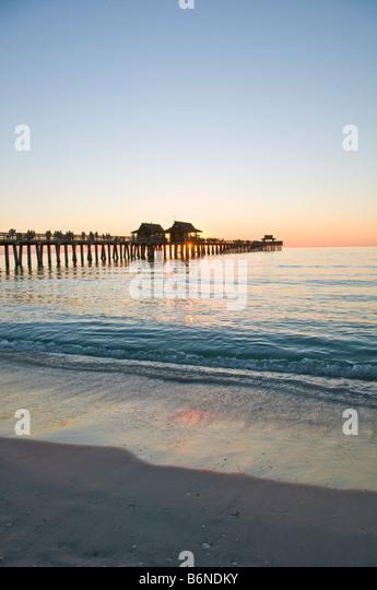 Naples Pier sunset Florida Naples Municipal Pier sunset Naples Fishing Pier fl southwest florida gulf coast - Stock Image