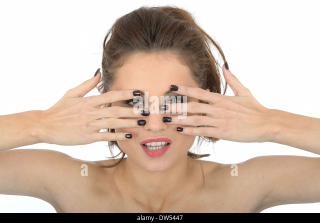 Young Woman Peering Through Fingers - Stock Image