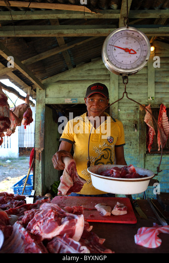 Caribbean, Dominican Republic, the seller of meat, food, market - Stock Image