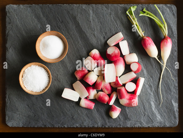 Fresh radishes with salt - Stock Image