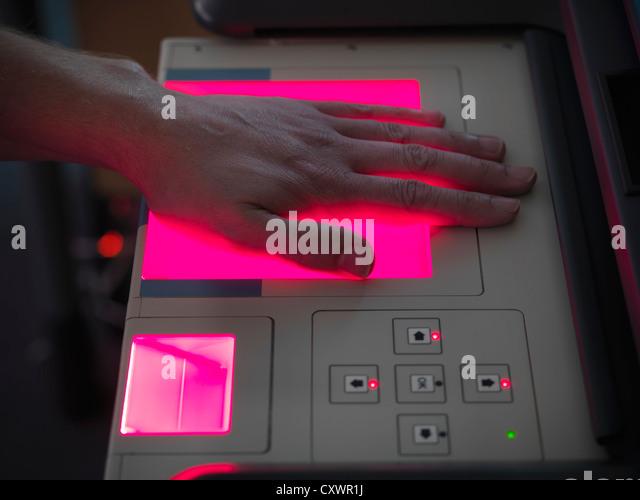 Forensic student taking fingerprints - Stock Image