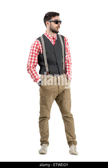 Macho hipster smoking cigarette looking away. Full body length portrait isolated over white studio background. - Stock Image