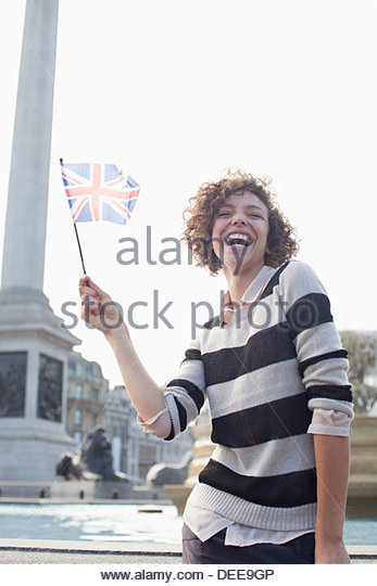 Happy woman holding British flag - Stock Image