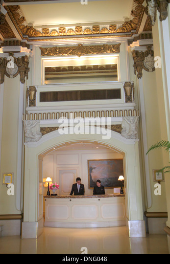 Hong Kong China Kowloon Tsim Sha Tsui Salisbury Road The Peninsula hotel inside interior lobby front desk check - Stock Image