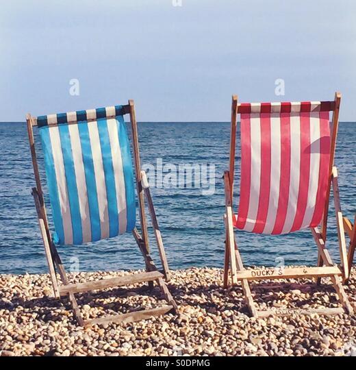 Deckchairs on Beer Beach, Devon - Stock Image