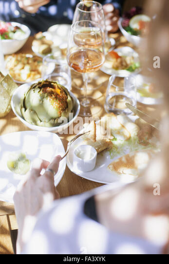Cropped image of couple having meze at Lebanese restaurant - Stock-Bilder
