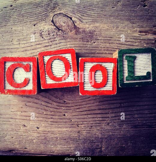 It's a photo of Woodblocks toy games with alphabet letters on them wich combine together to form the word COOL - Stock-Bilder