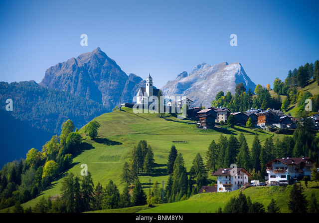 Italy Alps Veneto Dolomites Cadore hill wood forest meadows holidays travel, - Stock Image