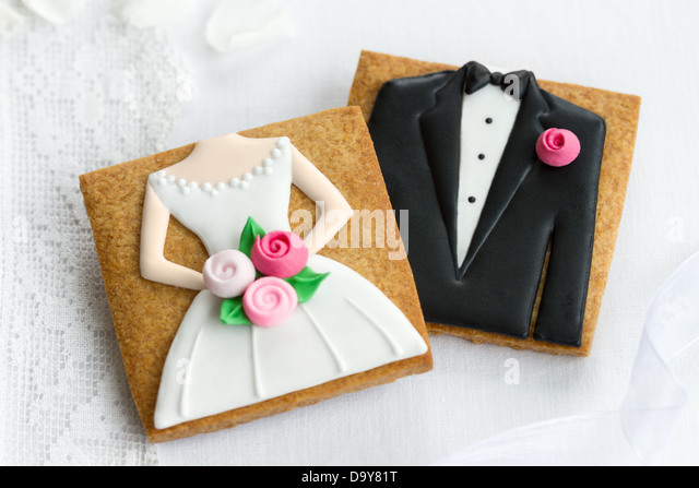 Bride and groom cookies - Stock Image