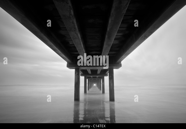 Photo taken under a pier in Port Aransas, Texas. - Stock Image