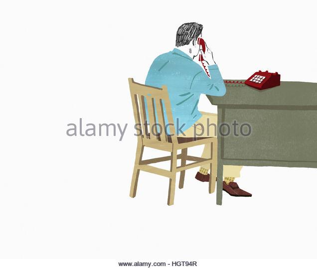 Man sitting at desk on landline telephone - Stock-Bilder