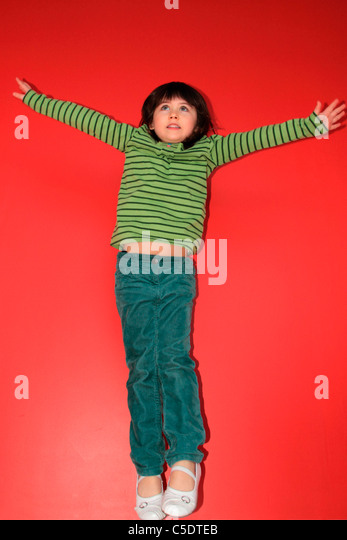 Young girl jumping - Stock Image