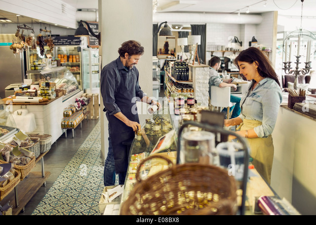 Salespeople working in supermarket - Stock Image