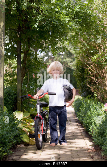 child with first bicycle - Stock Image