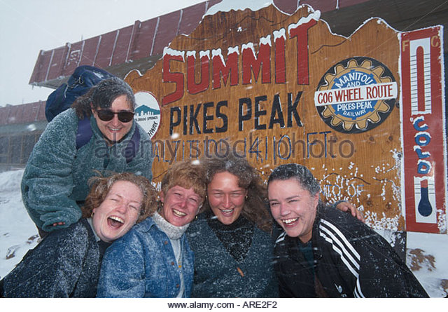 Colorado Colorado Springs Pike's Peak Summit altitude feet English women tourists September snowstorm - Stock Image
