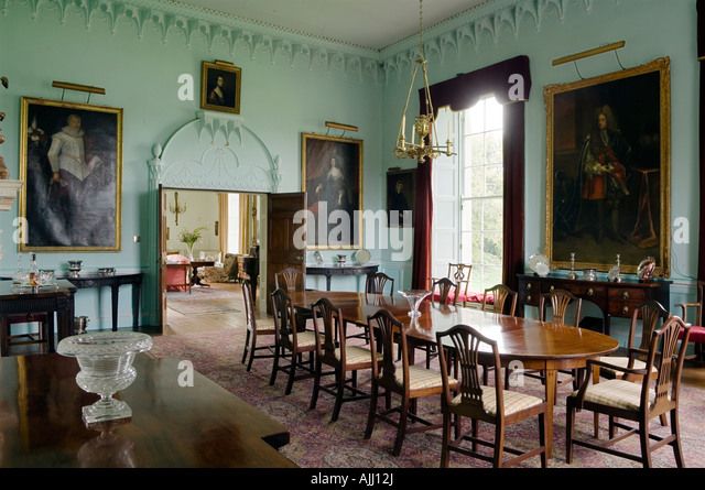 Dining room with oil paintings and double door in 17th century Irish castle - Stock-Bilder