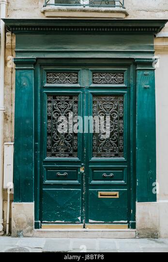 Old green doors in Paris - Stock Image