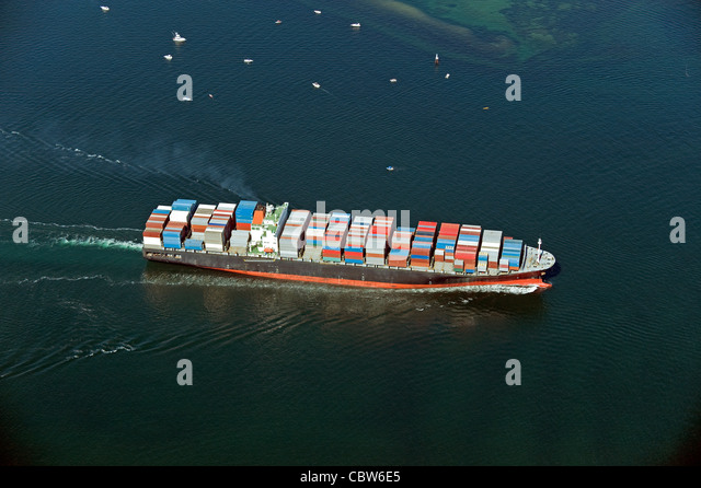 Ship with containers on the sea - Stock Image