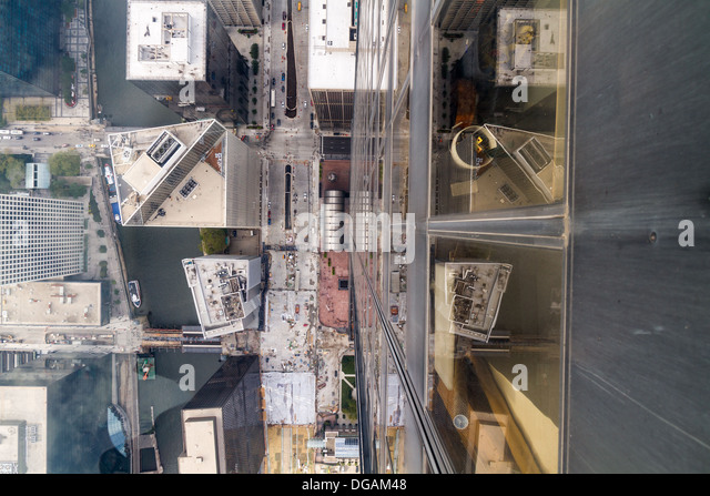 Looking down through glass floor at top of Willis Tower, Chicago - Stock Image