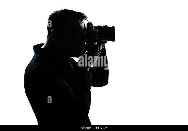 one caucasian man portrait silhouette photographer in studio isolated on white background - Stock Image