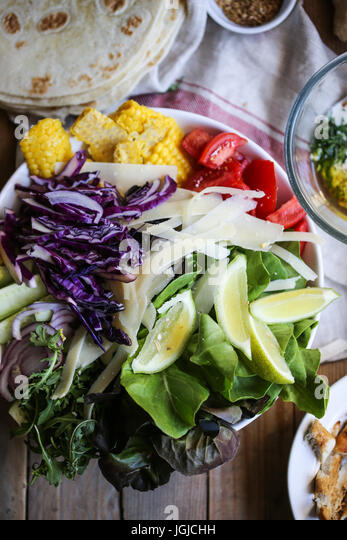 A plate full of fresh vegetables. - Stock Image