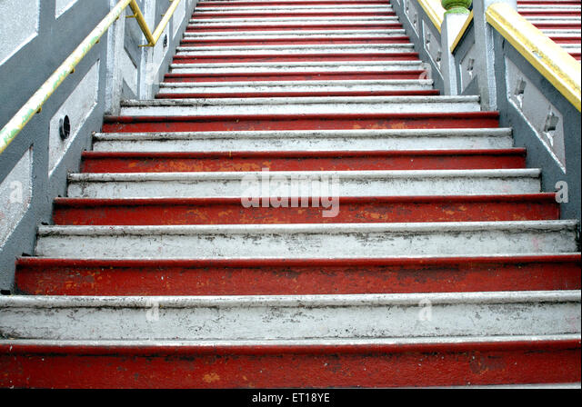 Graphic design red and white on steps of batu cave ; Malaysia - Stock Image