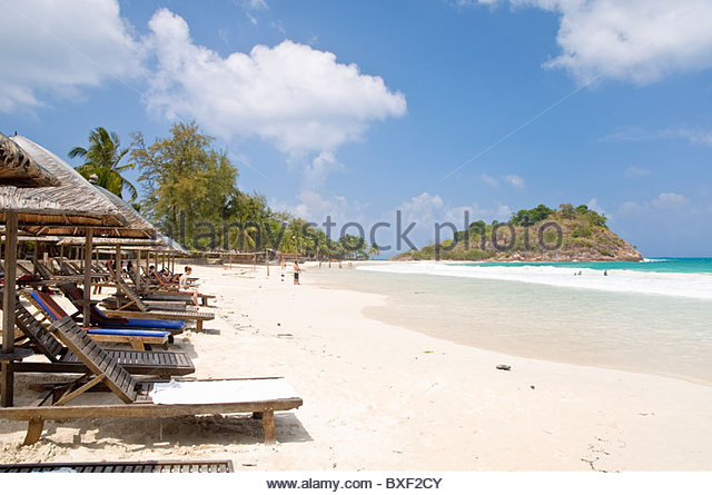 Beach with deck chairs, Pulau Redang island, Malaysia, Southeast Asia, Asia - Stock Image