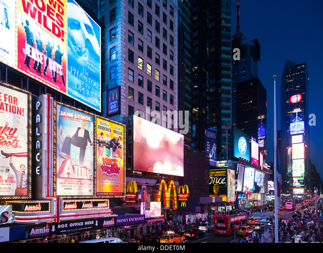 Advertising signs in Times Square at night, Manhattan, New York City, USA. - Stock Image