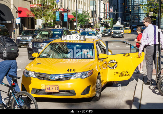 Chicago Illinois River North downtown South State Street East Grand Avenue traffic yellow taxi cab taxis cabs - Stock Image
