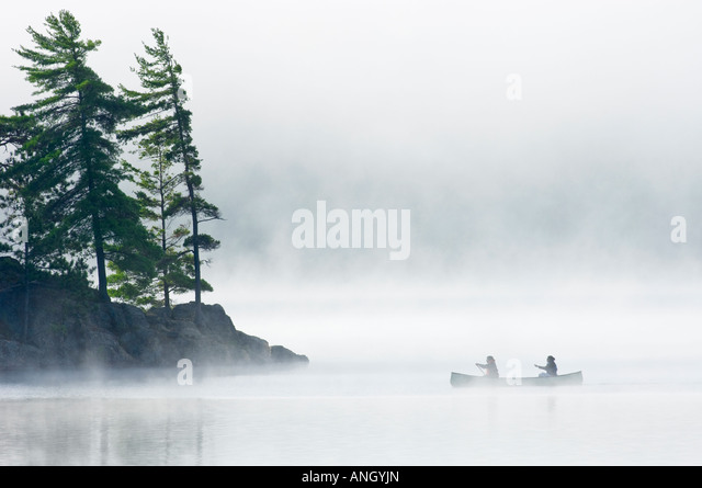 Canoeing on Lake of Two Rivers, Algonquin Provincial Park, Ontario, Canada. - Stock Image