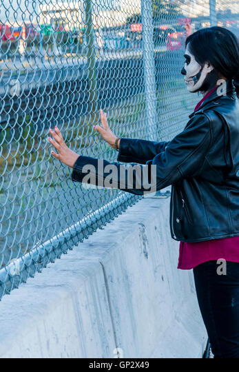 Zombie at fence - Stock Image