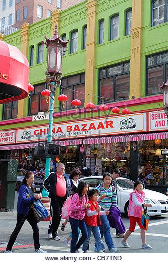 San Francisco California Chinatown ethnic neighborhood Grant Street kanji shopping street crossing pedestrian Asian - Stock Image