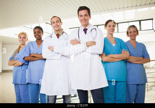 Doctors with nurses with arms crossed - Stock Image