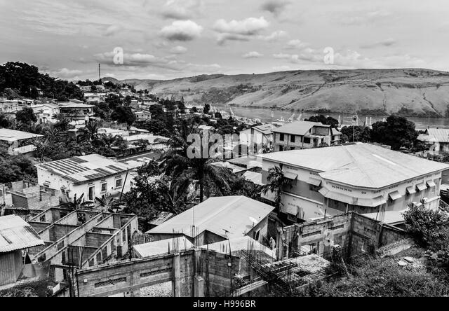The Congolese town Matadi at the Congo river in black and white. The city is built over several hills with wildly - Stock-Bilder