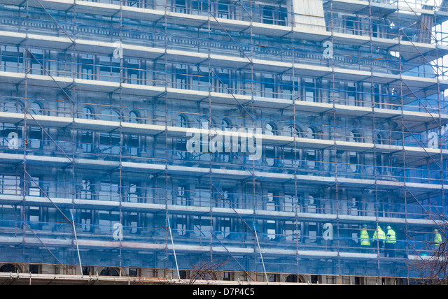 Screened scaffolding at construction site, Belfast, Northern Ireland - Stock Image
