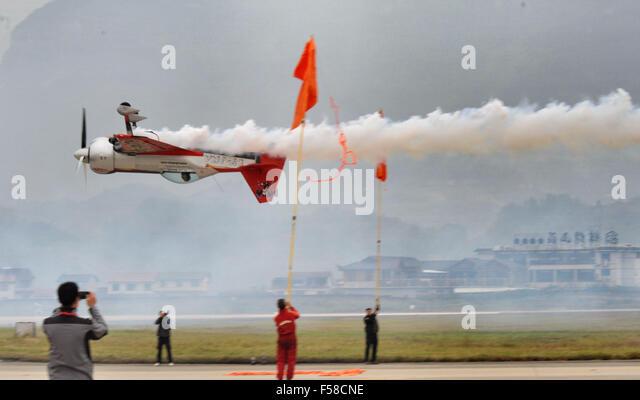 Zhangjiajie, China's Hunan Province. 30th Oct, 2015. An aircraft performs aerobatics during an international - Stock Image