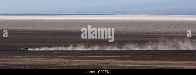 van travels on dirt road in the Furnace Creek area of Death Valley, California - Stock Image