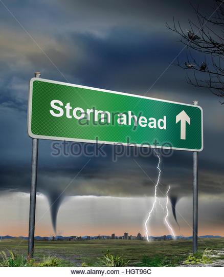 Road sign warning of storm ahead - Stock-Bilder