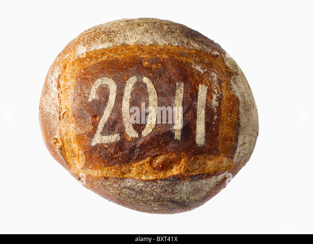 round loaf of bread dusted with the year 2011 - Stock Image