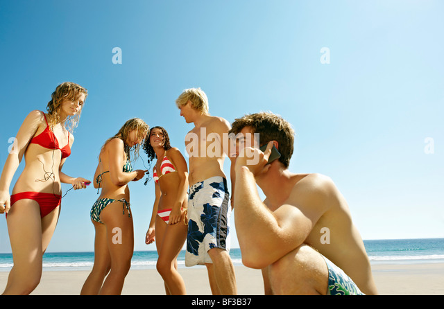 group of people on beach - Stock Image