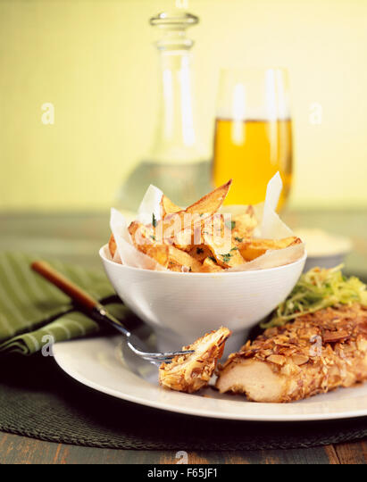 chicken with peanuts and chips - Stock Image