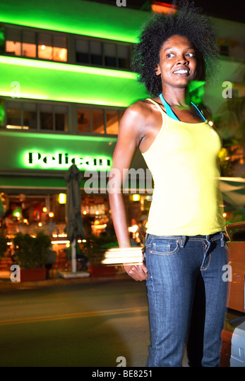 Young woman on Ocean Drive, South Beach, Miami Beach, Florida, USA - Stock Image