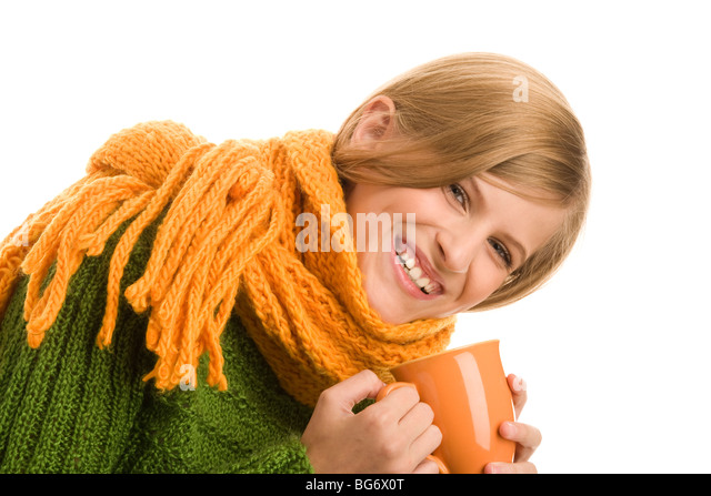 Portrait of beauty autumnal girl holding mug with hot beverage - Stock Image