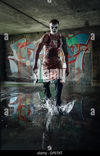 Bloody clown-maniac with ax - Stock Image